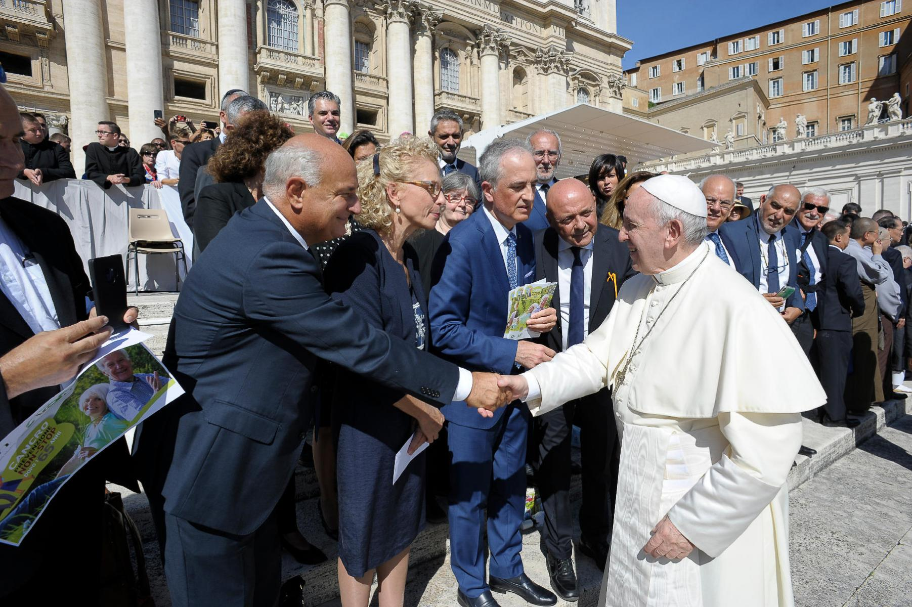 AIOM representatives meeting Pope Francis outside the Vatican
