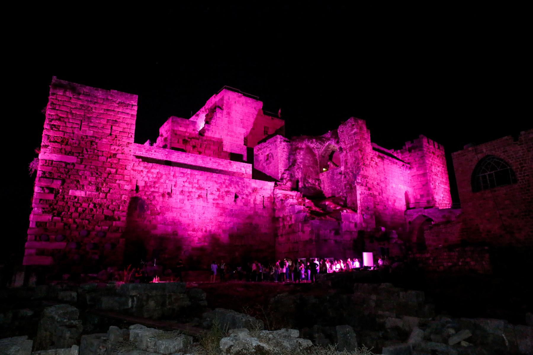 Byblos-Jbeil Castle at night, illuminated with pink lights