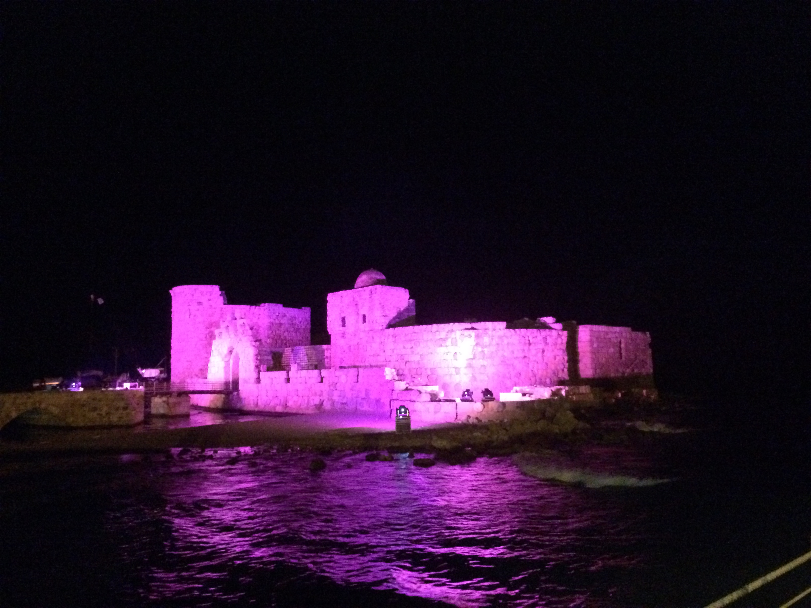 Sidon Sea Castle lit up with pink lights