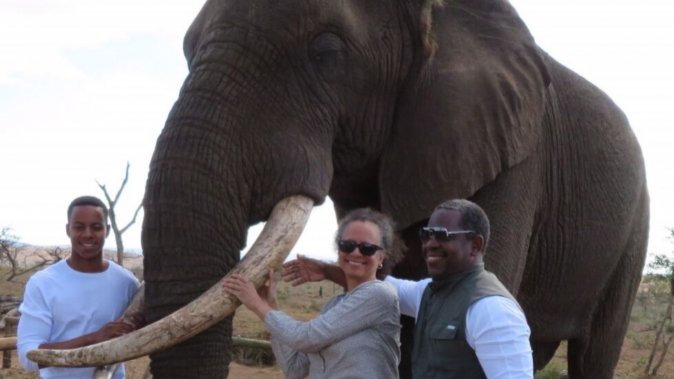 Dr. Pierce and her family with an elephant in South Africa.