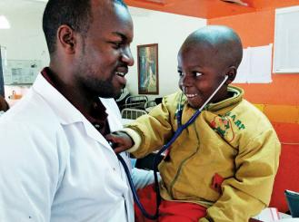 Dr. Fidel Rubagumya and a young patient with cancer at the Butaro Cancer Center of Excellence