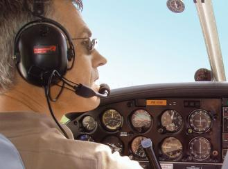 Dr. Verweij at the controls of a Cessna