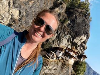 Dr. Jenkins hiking to the Taktsang Palphug Monastery, better known as Tiger's Nest, near Paro, Bhutan.
