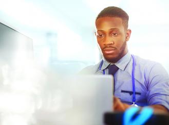 Stock graphic of doctor at computer