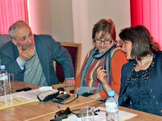 three people at a conference table