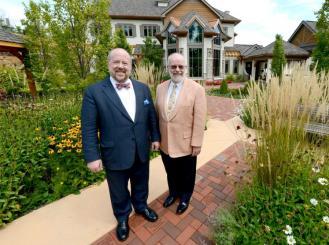 Dr. Charles von Gunten and Dr. Frank Ferris in a garden