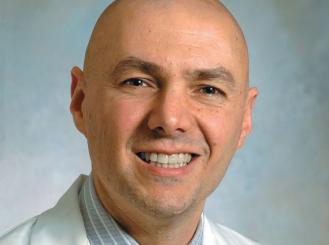 Dr. Ezra Cohen