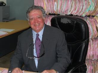 Dr. Robert Comis at a desk
