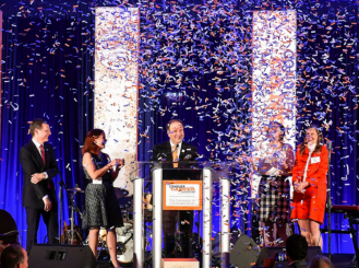 ASCO CEO Dr. Clifford A. Hudis, 2012 YIA recipient Dr. Breelyn Wilky, Conquer Cancer Board of Directors chair Dr. Thomas G. Roberts Jr., cancer survivor Brittany Sullivan, and Conquer Cancer chief philanthropic officer Nancy R. Daly