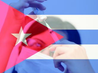 Healthcare professional behind a Cuban flag