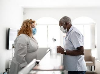 stock photo of Black medical professional and patient in medical office