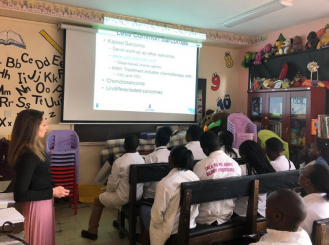 In Kenya, Dr. Libes teaches a team of health care providers about cancer treatment options for pediatric patients.