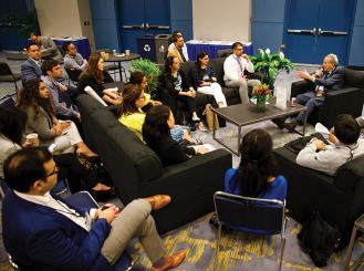 Dr. Joseph R. Bertino leads a discussion in the Trainee & Early-Career Oncologist Member Lounge in 2017
