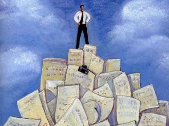 man standing on top of a huge pile of letters