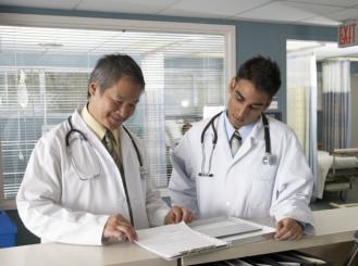doctors look at a medical chart