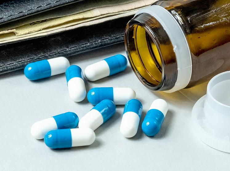 stock image of wallet and medication