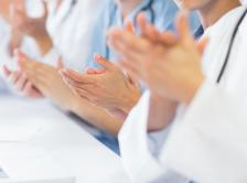 group of doctors clapping