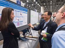 Dung T. Le, MD, (left) presents Abstract 6 in a Poster Session.