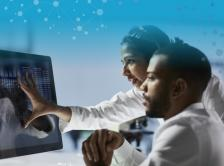 Two doctors looking at computer
