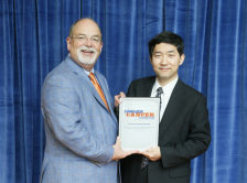 Jianjun Zhang, MD, PhD, with W. Charles Penley, MD, FASCO, Conquer Cancer Past Chair