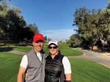 Dr. Weisberg golfing with her husband