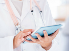 Image of doctor holding an iPad