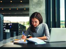 Stock image of woman studying