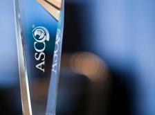 glass trophy with ASCO logo
