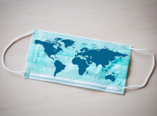 surgical mask with world map printed on it
