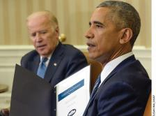 Photo of President Obama and Vice President Biden with a summary of Cancer Moonshot Report