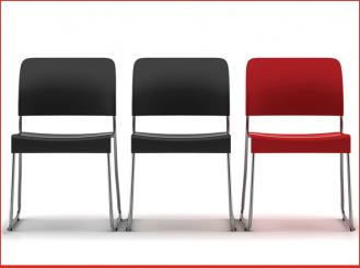 two black chairs and one red chair