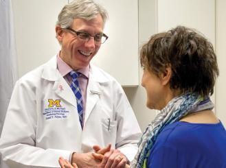 Dr. Daniel Hayes with a patient
