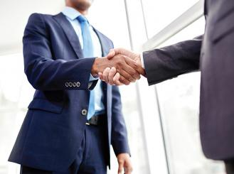 Stock image of two professionals shaking hands