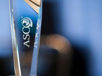 glass trophy with ASCO logo