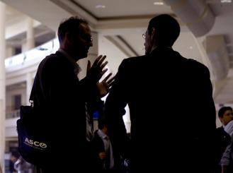 two ASCO members talking
