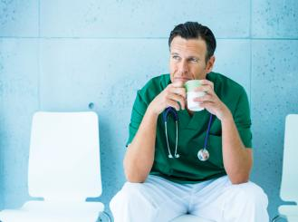 Stock image of a doctor or nurse drinking coffee
