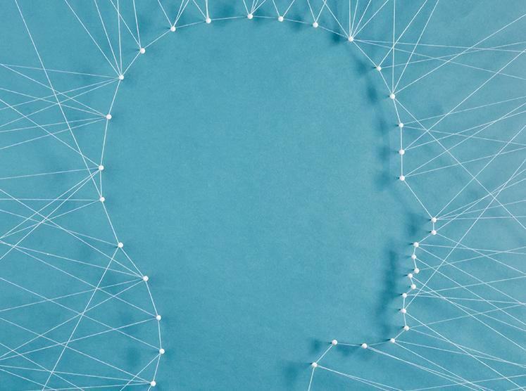 Stock image of the outline of a person's head using connected strings
