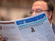 attendee reading ASCO Daily News